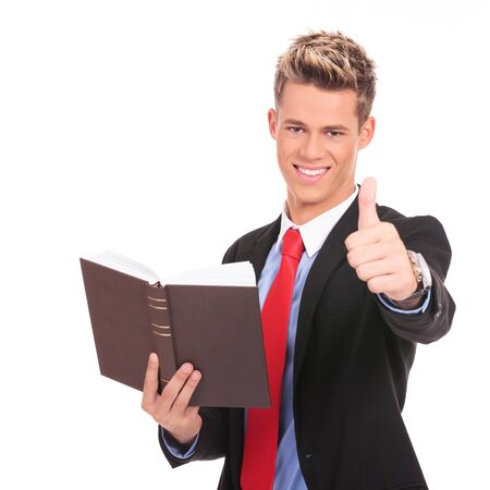 young business man or law student reading and giving the ok for the book  photo