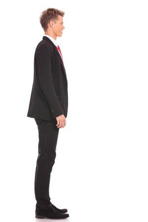 looking sideways: Business man waiting in queue on white background