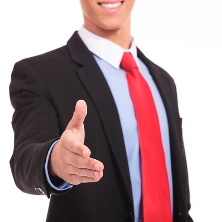 Businessman handshake isolated on a white background photo