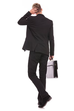 corporate responsibility: Rear view of a business man thinking, isolated on white background  Stock Photo