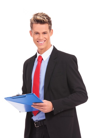 Portrait of a male business executive taking a notes on clipboard against white background  photo
