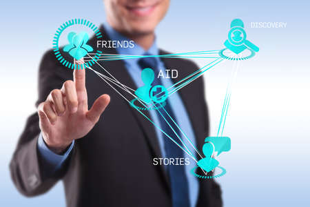 Business man pressing modern social buttons on a virtual background Stock Photo - 17243924