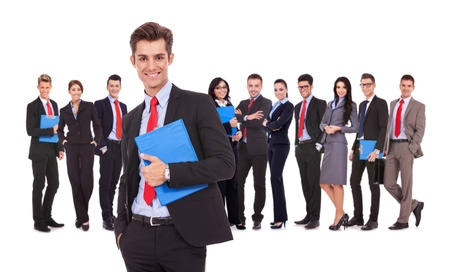 Leader holding a clipboard with business team behind, isolated on white. successful happy businessteam with a young man as a leader, holding a notepad and looking at the camera Stock Photo - 17243932