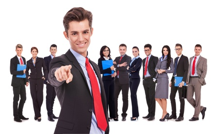 leader of a successful business team is choosing you to join them by pointing his finger photo