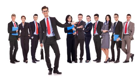 Successful happy business team being presented by a young leader, on white background. young business man welcoming you to his business team  photo