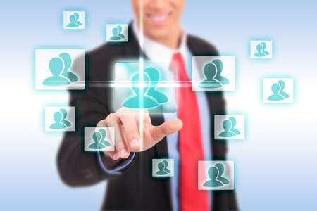 smiling business man pressing the add friend button on a social network virtual screen Stock Photo - 17242412