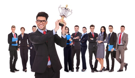 winning business team with a man executive holding a gold trophy cup photo
