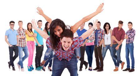 excited young couple playing in front of a large group of fashion casual people Stock Photo - 17449686