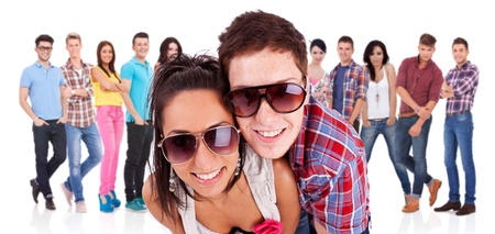 young couple in front of a large group of casual fashion people Stock Photo - 17449626