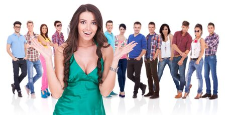 excited young beautiful woman in front of a group of casual people Stock Photo - 17449663