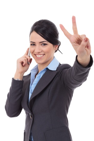 business woman phone: Happy business woman with phone and victory gesture, isolated Stock Photo
