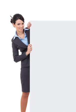 Young businesswoman with blank board. Isolated over white. photo