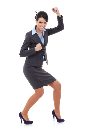 picture of a very happy businesswoman winning over white photo