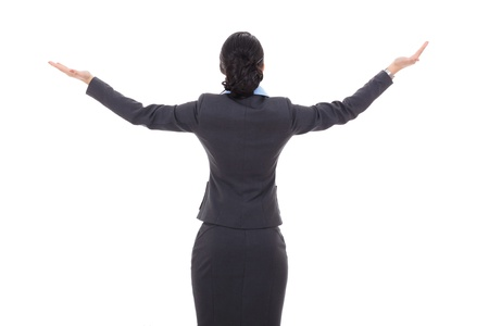 outstretched arms: back of a business woman with her hands in the air on white background