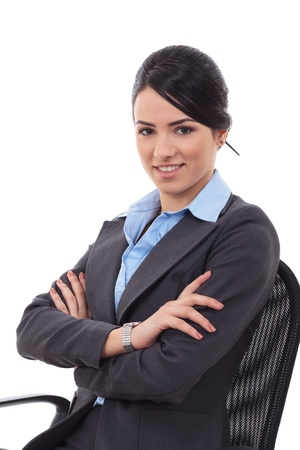 folded hands: Isolated young business woman sitting in office chair Stock Photo