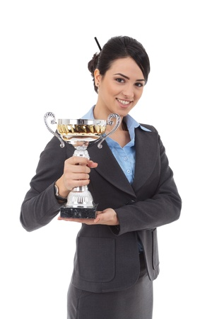 Portrait of an attractive young business woman winning a trophy against white background Stock Photo - 17449767