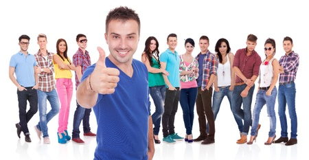 young casual man making the ok thumbs up gesture in front of his firends Stock Photo - 17449653
