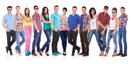 Happy smiling  group of friends standing together in a row isolated on white background Stock Photo - 17449610
