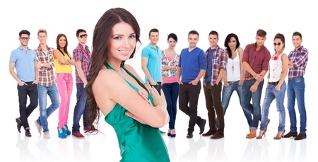casual young woman as a leader of a young large team  Stock Photo - 17449651