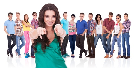 young casual woman choosing you for her team by pointing her finger photo