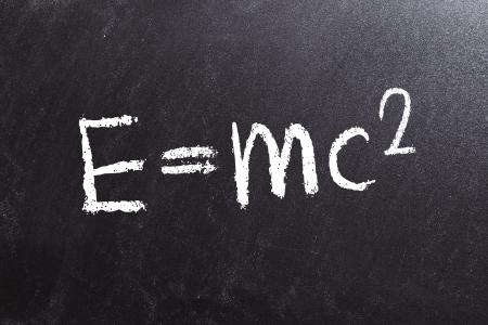 the theory of relativity formula, written on a blackboard photo