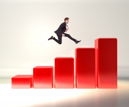 businessman jumping: winning business man jumping o top of a 3d graph  Stock Photo