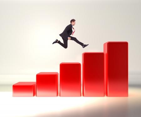 jumping businessman: winning business man jumping o top of a 3d graph  Stock Photo