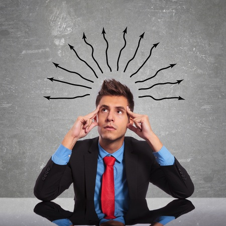 seated business man is concentrating really hard at some ideas Stock Photo - 17625004