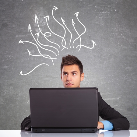 young business man using the laptop computer is thinking at hot to resolve some problems  Stock Photo - 17624942