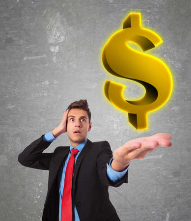 wondering: business man looking shocked  at how big is the american dollar Stock Photo
