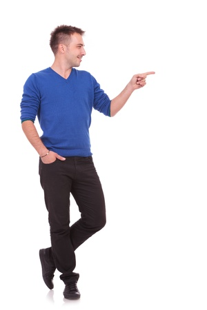sideways: Full length picture of a handsome man showing something to the side, isolated on white
