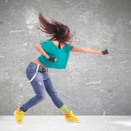 headbanging woman dancer  in a full of energy dance move and screaming photo