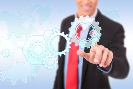business man driving business process gear of vision Stock Photo - 17825495