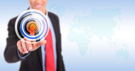 Businessman pressing circle button on a virtual background photo