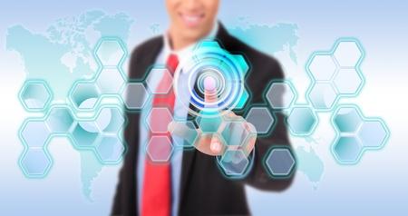 worldmap: Business man pushing digital button on touch screen interface