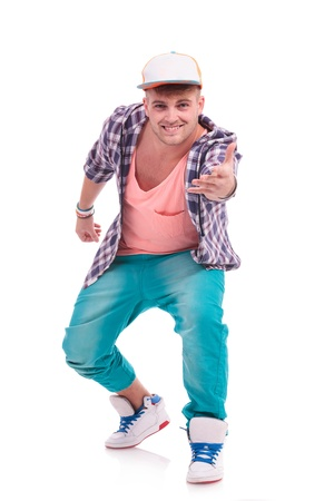 breakin: young male dancer holding his hand out and smiling to the camera, on white background Stock Photo