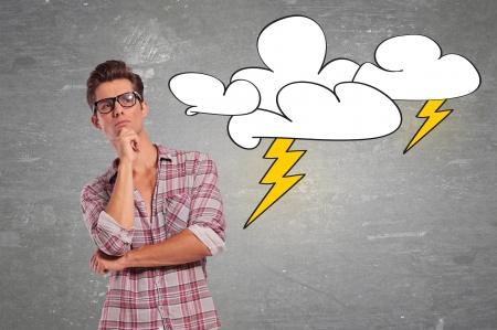young casual man with glasses facing a big problem and thinking for a solution Stock Photo - 18025211