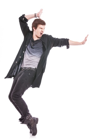 dance pose: young male dancer showing some skill, on tiptoes, showting