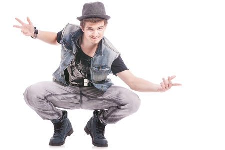 young male dancer standing in a crouch pose with his arms opened, welcoming you photo