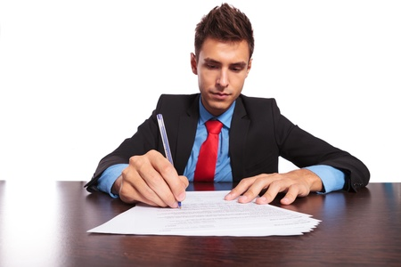 young business man writing something at the desk Stock Photo - 18025380