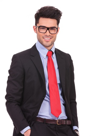 smart man: attractive young business man looking at the camera with his hands in his pockets and smiling, isolated on white Stock Photo