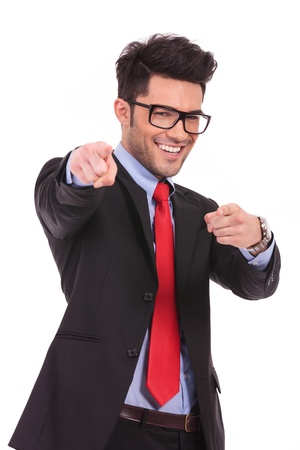both: young business man pointing towards the camera with both hands and smiling, isolated on a white background
