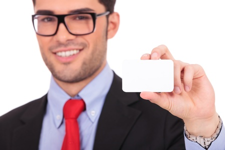 Portrait of young business man isolated on white background. Holding blank business card and smiling photo