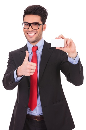 identification card: young business man presenting a blank card and showing thumbs up sign while smiling at the camera on a white background