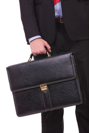 suit case: closeup picture of a young business man holding a briefcase on a white background Stock Photo