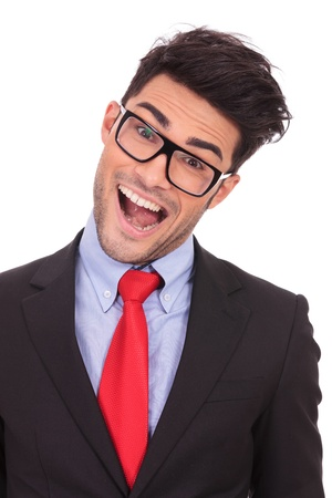 tilted: closeup portrait of a young business man acting crazy, tilting his head and opening his mouth while looking at the camera on a white background  Stock Photo