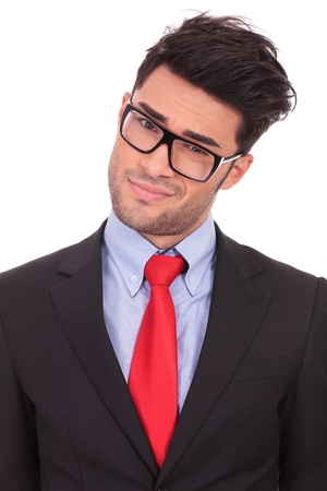 head tilted: closeup portrait of a young business man with head tilted to a side is looking at the camera suspiciously, on a white background