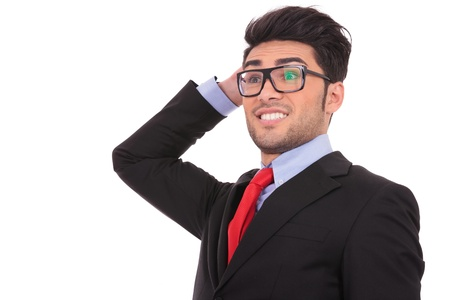 confused man: closeup view of a confused young business man scratching the back of his head, while looking away, on white Stock Photo