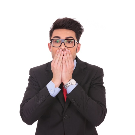 censor: young business man covering his mouth over white background Stock Photo