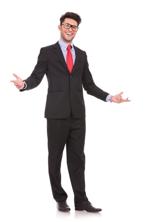 full length picture of a young business man wellcoming everybody with his arms wide opened and with a large smile on his face, on white background photo